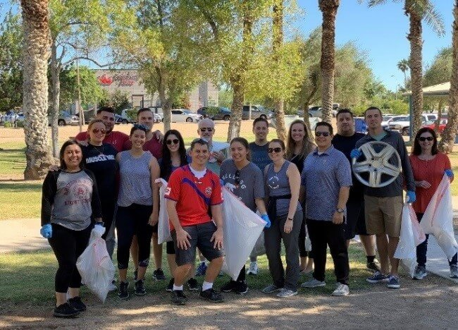 Kforce Phoenix office cleaning up litter at Arcadia Park